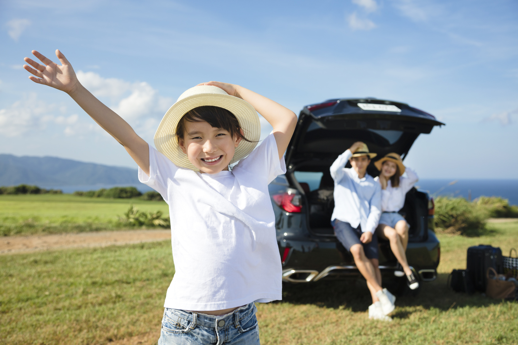 happy Family with littlt girl travelling by car